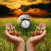Stock Photo of Time to planting for save the green earth concept