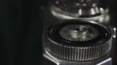 Photographer winding film on an old camera Stock Footage