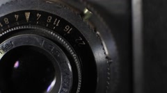 Photographer changes settings on an old film camera Stock Footage