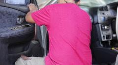 Unidentify engineer repair the door of car Stock Footage