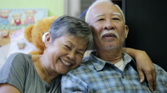 Happy asian senior man and woman hugging and smiling in front of camera. Stock Footage