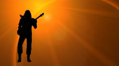 Rock musician silhouette left of frame Stock Footage
