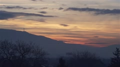hectic sunset with beautiful clouds over the mountain - stock footage