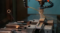 Cnc machine working piece of aluminum while the water cools drill Stock Footage