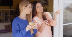 Two young woman enjoying refreshments - stock footage