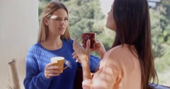 Two women having a friendly chat Stock Footage