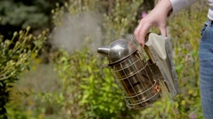 A beekeeper using a smoker. - stock footage