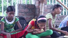 Girl students eating vegetarian food at a village school  in India Stock Footage