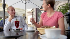 Happy couple at outdoor European cafe. - stock footage