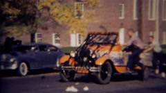 1952: Teenage boys with High School Homecoming Dance car. GREELEY, COLORADO - stock footage