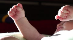 Baby clinching his fist - stock footage