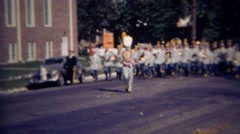 1952: Gray marching band plays music down campus street. GREELEY, COLORADO Stock Footage
