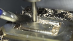 Worker cleaning with brush brass being drilled by industrial drill, slider shot Stock Footage