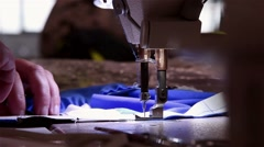 Woman working on an sewing machine Stock Footage