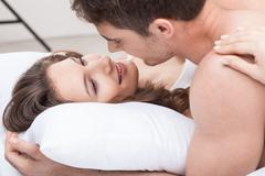 Stock Photo of Attractive man and woman are relaxing in bedroom