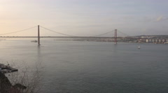 Lisbon Portugal view of the Tejo river and 25 de Abril Bridge Stock Footage