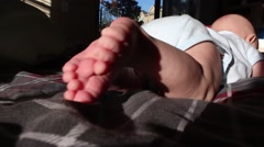 baby lying on his belly - stock footage