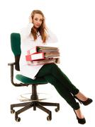 Stock Photo of Paperwork. Overworked doctor woman with documents