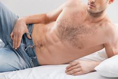 Cheerful fit man is expressing his passion - stock photo