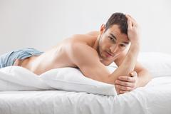 Attractive fit guy is expressing his desire - stock photo