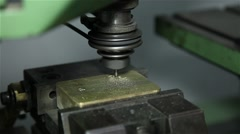 Engraving machine working on a brass piece Stock Footage