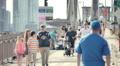 Brooklyn Bridge people pedestrians bicycles New York City NYC sunny slow motion HD Footage