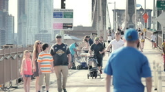 Brooklyn Bridge people pedestrians bicycles New York City NYC sunny slow motion - stock footage