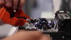 man using fiber optic fusion machine - stock footage