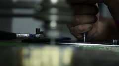 man using engraving machine in a brass piece, focus defocus - stock footage
