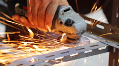 Unidentify worker grinding metal construction with a circular saw Stock Footage