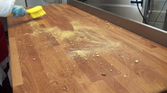 Stock Video Footage of Cleaning Wooden Table from the bread crumbs yellow brush.
