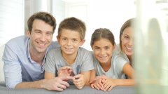 Portrait of happy family of four - stock footage