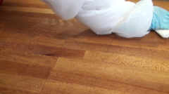 Clean surfaces and angles of a wooden table with a damp cloth. - stock footage