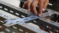 Unidentify worker Man strong work-worn hands unscrews the with a wrench bolt Stock Footage