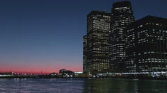 New York Financial District as the sun has just set on the horizon Stock Footage