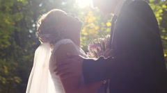 Bride and groom kissing in the forest - stock footage