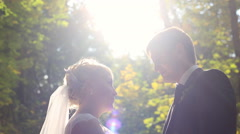 Bride and groom kissing in the forest Stock Footage