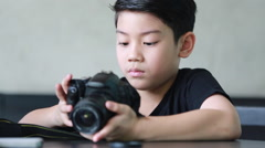 Asian boy looking and shoot with DSLR camera Stock Footage