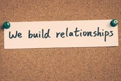 we build relationships - stock photo