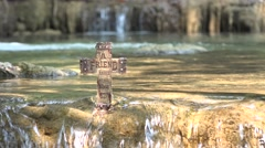 Christian cross in a fresh water stream. - stock footage