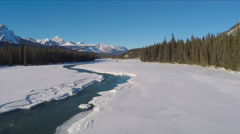 Aerial Shot Jasper Snow Covered Mountains Frozen River Lake Ice Forest Drone Stock Footage