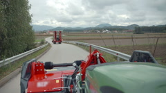 Tractors are going on fields to begin ploughing  - stock footage