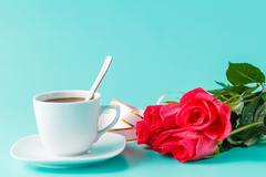 Cup of coffee with rose Stock Photos
