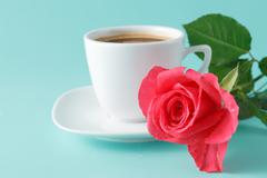 Cup of coffee on the table with rose flower Stock Photos