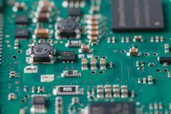 Closeup on electronic board in hardware repair shop - stock photo