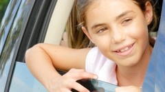 Young girl showing head through car window Arkistovideo