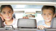 Kids looking by car backseat while traveling Stock Footage