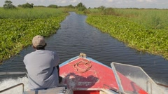 SLOWMOTION Boat on river with green shores,Tonle Sap,Cambodia - stock footage