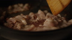 Slow motion bacon frying in pan Stock Footage