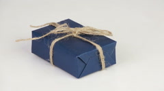 Gift box covered with blue wrapping paper Stock Footage
